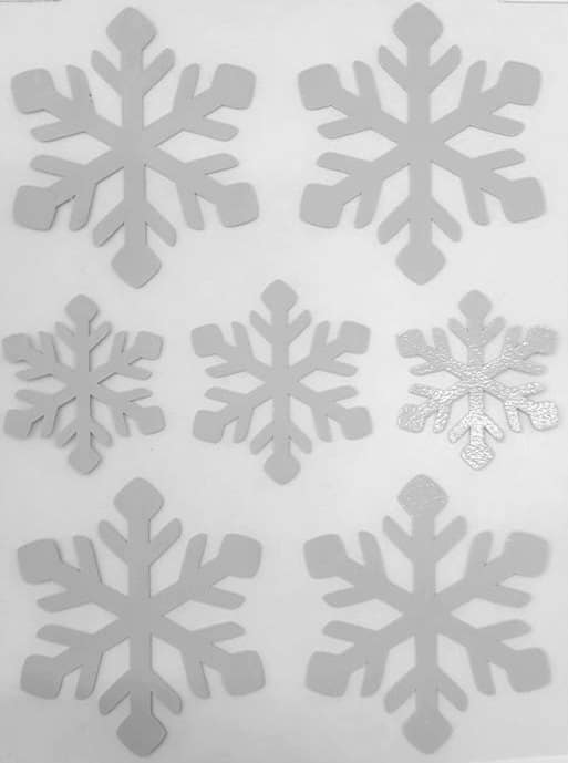 Triigitav helkiv embleem, lumehelbed