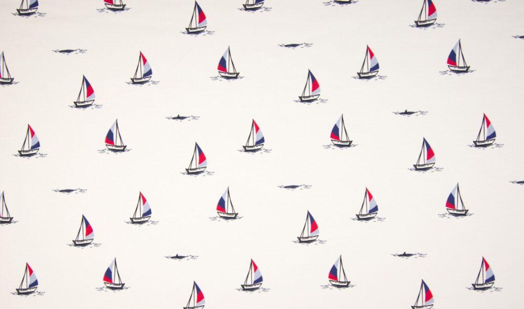 Trikotaažkangas väikesed purjepaadid valgel Single Jersey