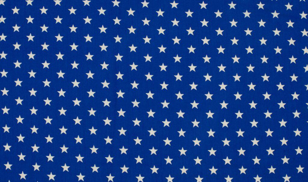 Trikotaažkangas valged tähekesed royal-sinisel Single Jersey